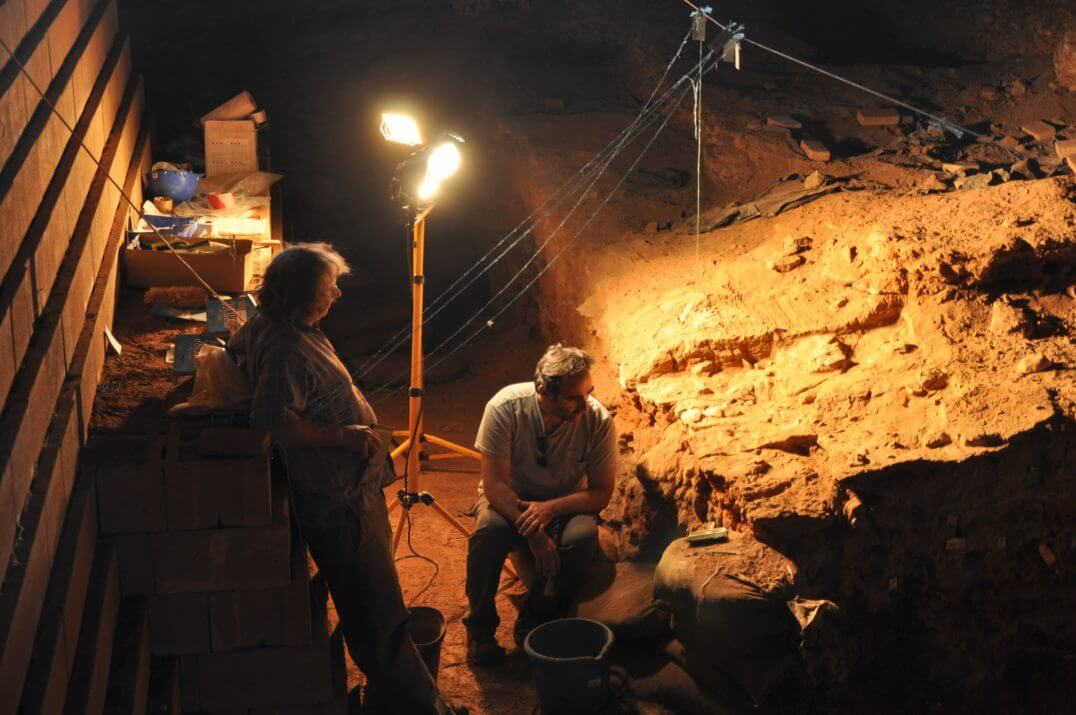 Michael Chazan (left), Francesco Berna (right), and their colleagues found evidence of 1-million-year-old wood ash inside Wonderwerk Cave in South Africa, which was used by hominins as far back as 2 million years ago