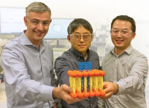 Alex Noy and team members with a model of a carbon nanotube