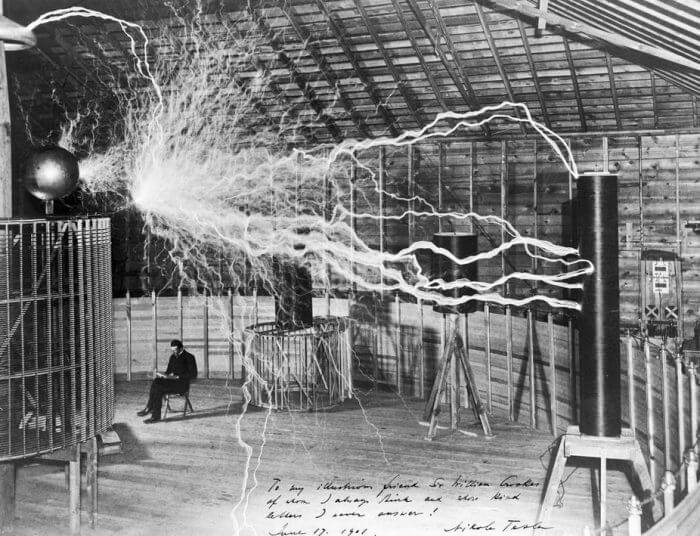 Nikola Tesla and his famous coil