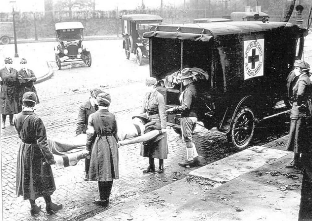 American Red Cross volunteers carry a Spanish flu victim in 1919